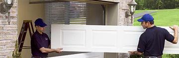 Two Garage Door Contractors Removing A Door