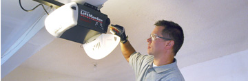 Technician Fixing A Garage Door Opener That Stopped Working